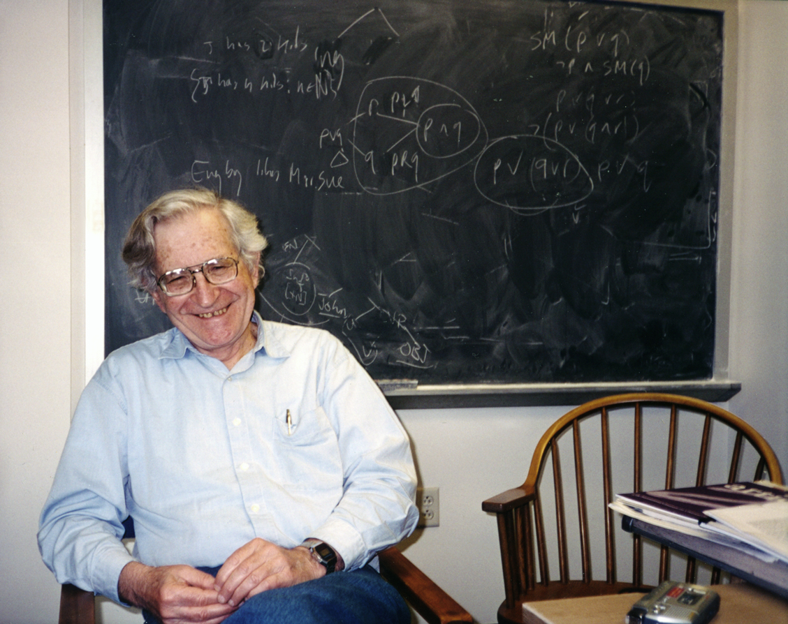 Noam Chomsky smiles. Wow.